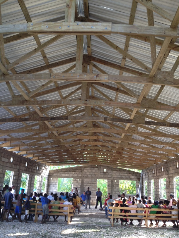 AFTER -- Worshipping with a thankful church under their new roof and seated on their new benches!