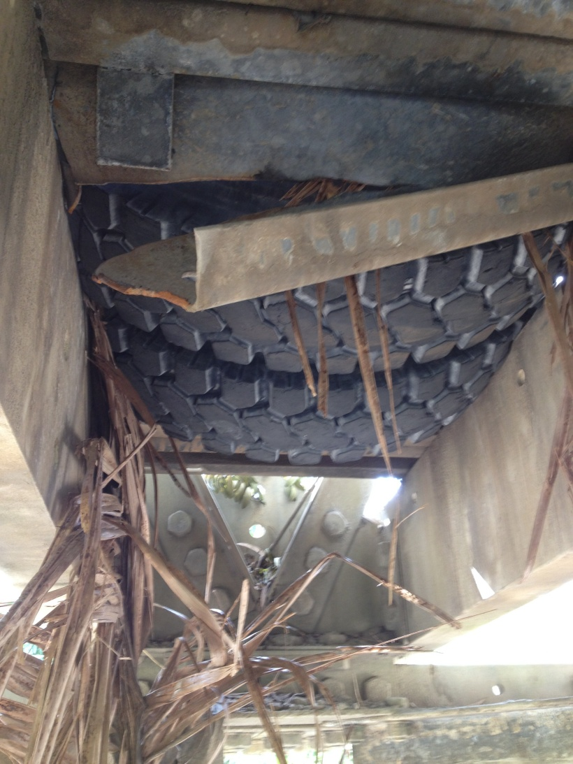The view from under the bridge showing our tires lodged in the hole!