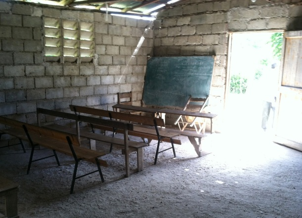 "I love how the light bursts through the doorway of this  empty, dimly lit classroom.  It reminds me of Psalm 119:130...""The entrance of Your word gives light."" Who can put a price on a Christian education in a third world country?"