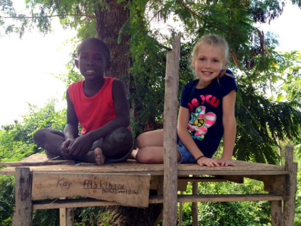 ere are Grace and Mackenson, one of her buddies, in his tree house. Mackenson is a sweet boy that Tim & Joan Reinhard are adopting. He loves to play with Grace!