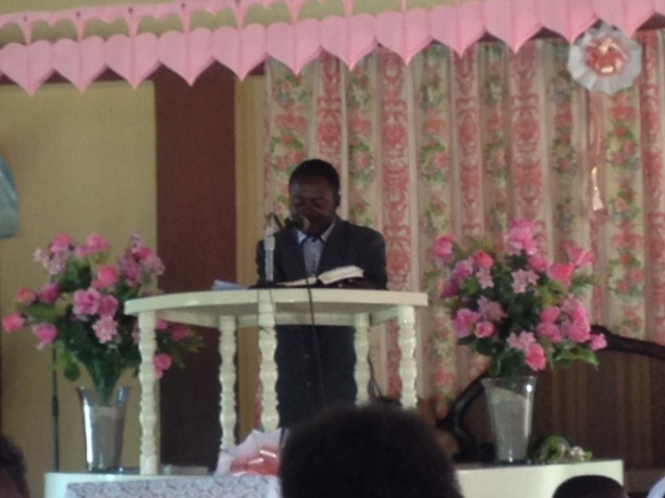 Pastor Jean-Claude preaching in his church near the airport north of Les Cayes.
