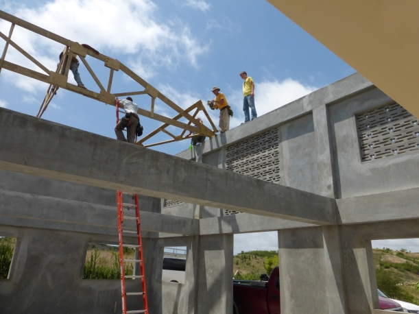 The first trusses are being placed over the two-story sanctuary end.