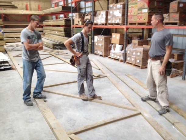 Careful planning for the graduated trusses that would produce the hip roof.