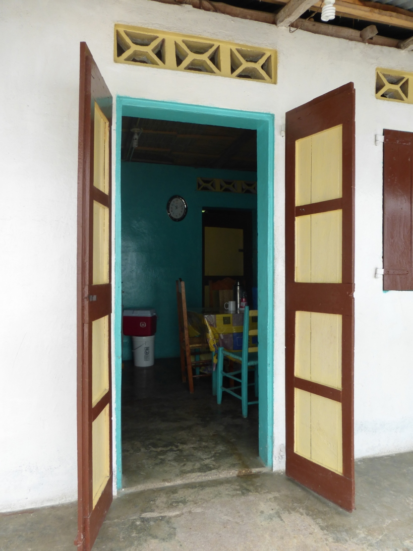 The doors and windows were shutter-style and had large hooks to secure them shut!
