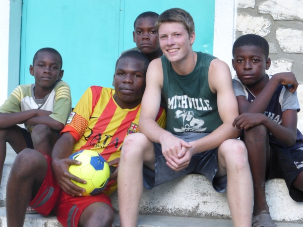 This is our favorite photo! Grant got to teach so many boys a few sports moves.