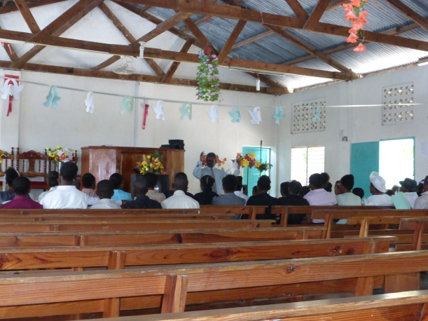 Singing practice after church. Every MEBSH church has the same tin roof and the same benches!