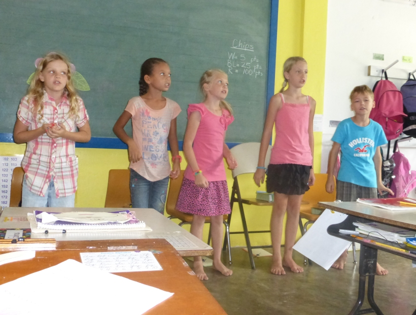 The class held a program for the parents. Where else can you go barefoot to school?