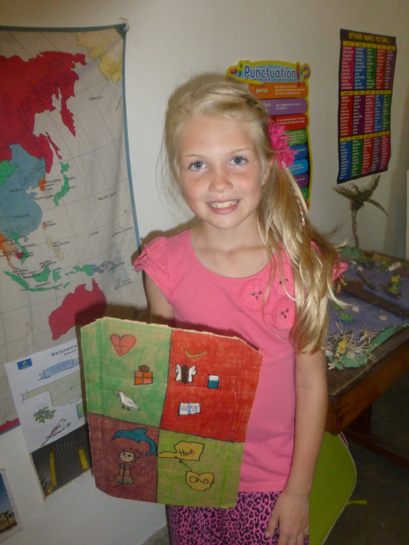 Grace has finished second grade! She is showing us her decorated shield of faith.
