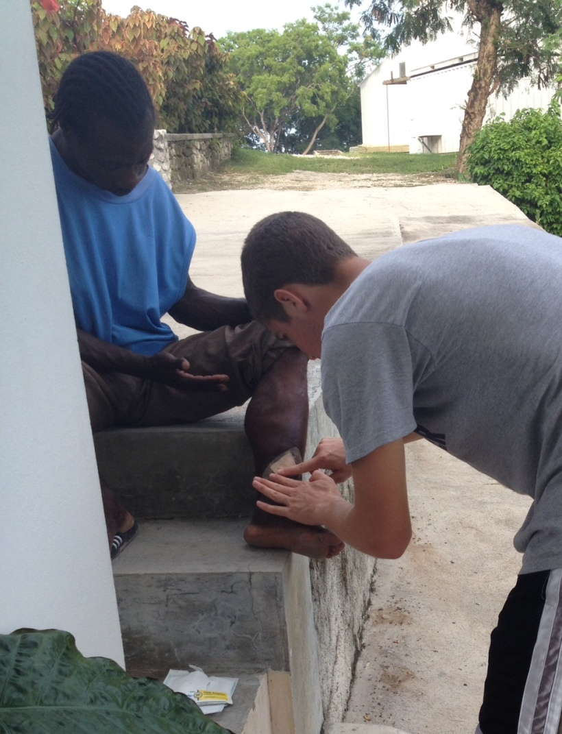 Evan found a mission in no time...he is taking this deaf man to the clinic all week for help with his leg injury. This bandage is really standing out for some reason!
