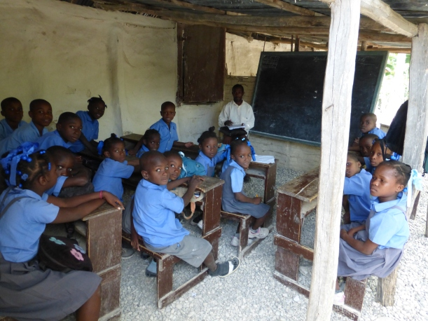 Classrooms in Haiti consist of a blackboard, chalk, a few desks and shelter from the sun. The kids primarily learn and recite from memory.