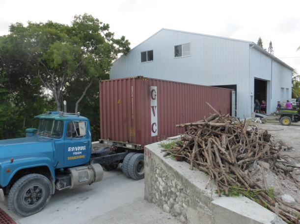 The sea container is driven across Haiti after being shipped from Miami to Port-au-Prince.