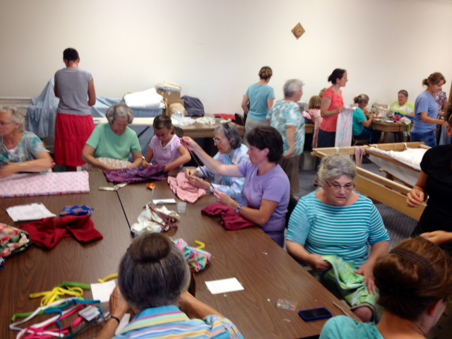 A huge evening where many came together to make pillowcase dresses for Haitian girls!