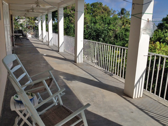 The back porch, where there is space to hang laundry or feed crowds of people!