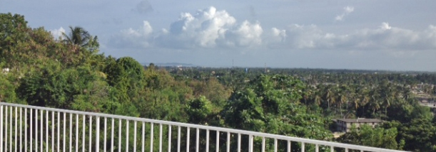 The roof has a wide view of the city of Les Cayes, the ocean and the island of Ile Vache beyond.