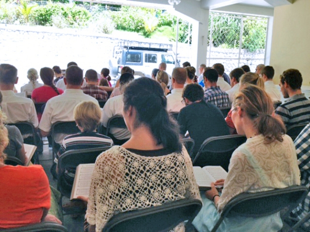 """We cleared out the """"garage"""" and had English church this month! The people closest to the back are neighboring missionaries, and in front of them is part of the work team!"""