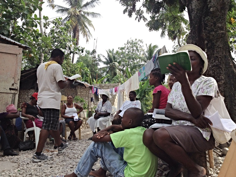 A great shot of Haitians sharing God's Word together!