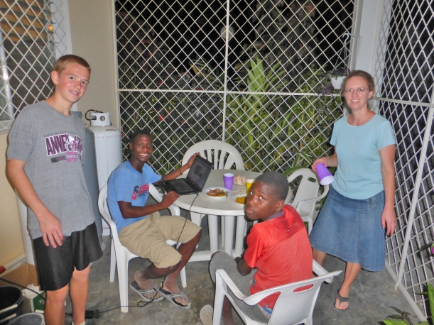 Meeting Nathanael, their sponsored child (seated at right) was a highlight of the trip!