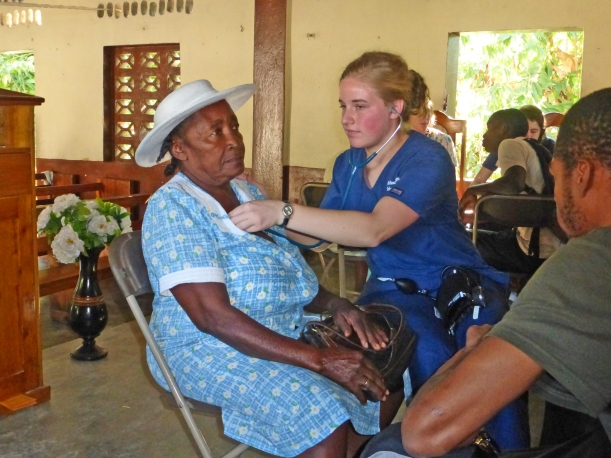 Natalie, hard at work giving blood pressure checks at the community clinic the team held for three days!