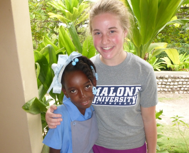Natalie meeting her family's sponsored child, Jenny, for the first time!