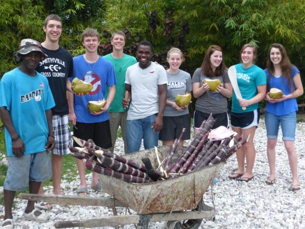 Enjoying coconuts and sugarcane! Left to right: Evan, Joe, Grant, Natalie, Margeau, Corrina & Grace.