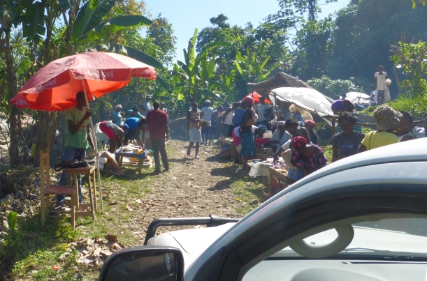 We came upon a village market day. They had to move everything for the truck to get through!