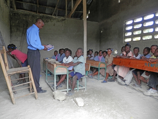 A typical Haitian classroom. With lack of books, lessons for the most part are memorization by loud group participation