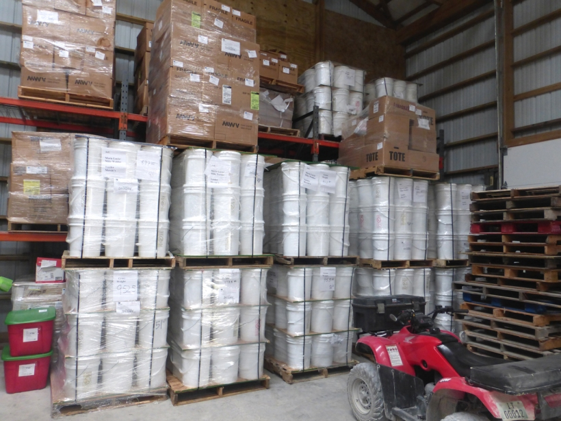 Our section of the storage depot is quite full right now! Buckets of food, boxes of school kits, soap and story book