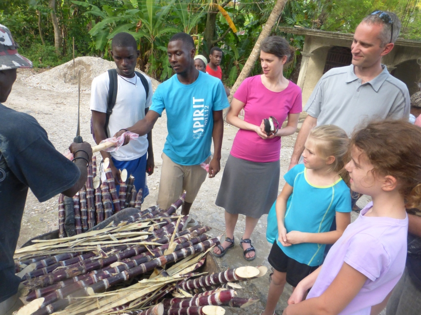 While walking through a local village, we stopped to taste sugarcane, which the seller cut on the spot!