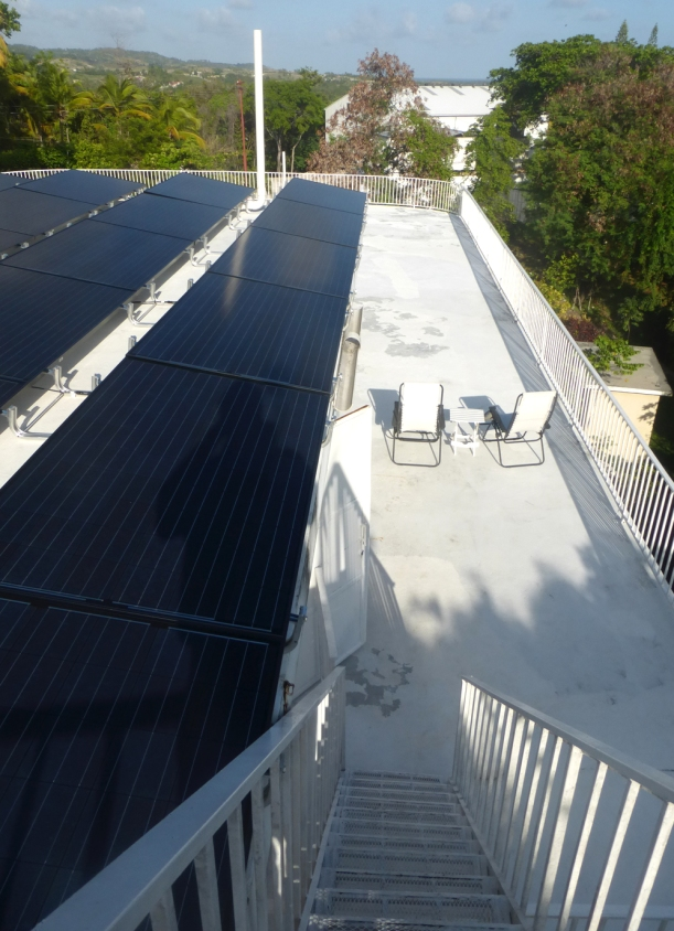 The solar panels cover the entire second story flat roof!