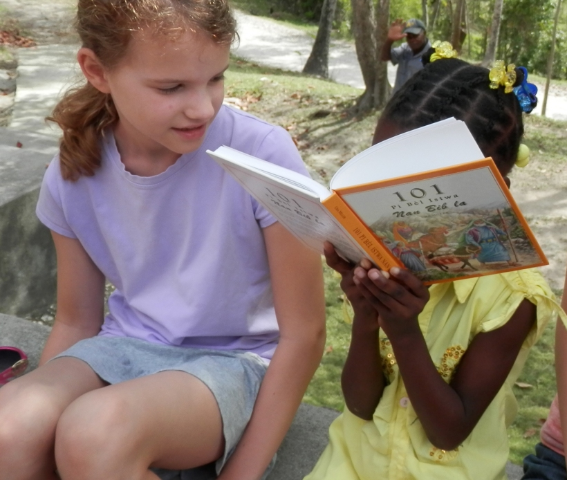 Enjoying a story from the Creole 101 Favorites storybook!