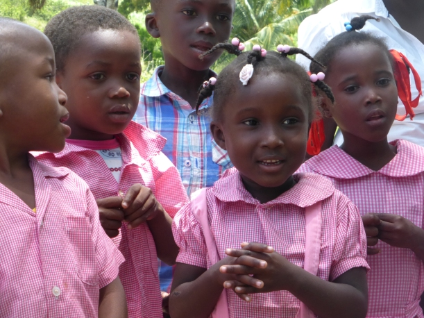 This class sang a song for us and the center girl's innocence caught my eye!