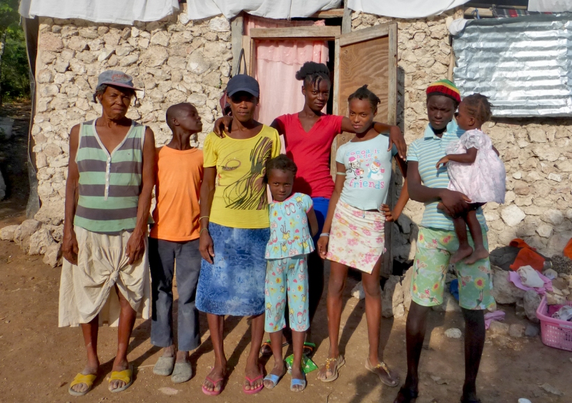 The sponsored child is in the bright red shirt with the rest of her family. Her grandma on the far left. Her 19 year old sister, with her baby, on the far right.