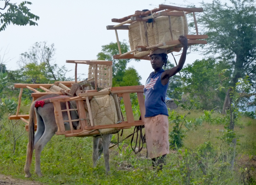 Here is a lady coming down the mountain to sell her chairs. Adline did buy one from her. She was happy!