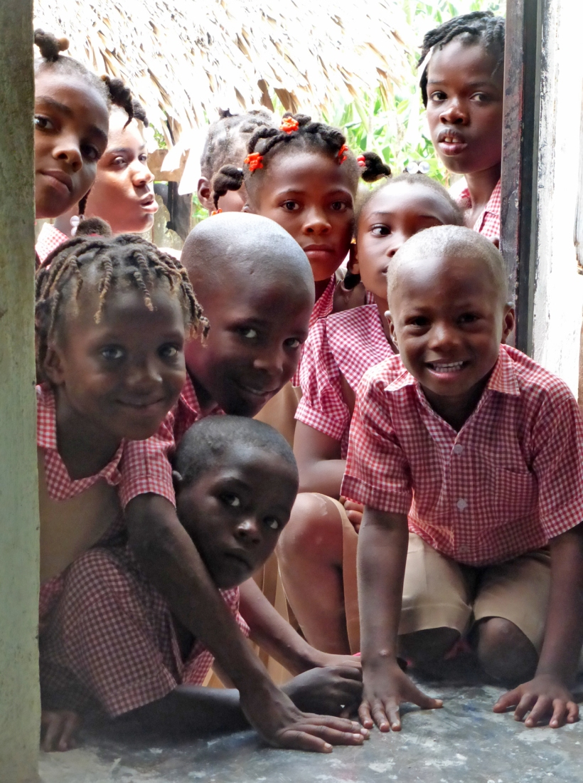 These precious kids were so curious and they looked into the door while the dresses were being passed out.