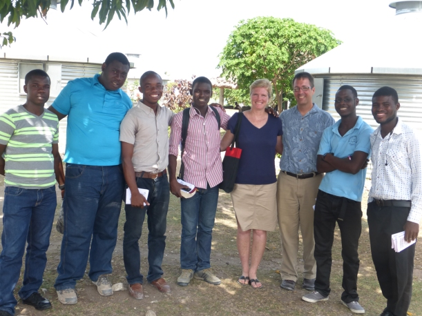 """Sharing the gospel with young Haitian believers at a """"grain bin"""" community of homes."""