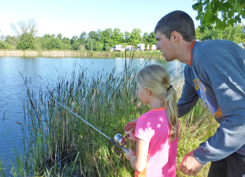 Here is Evan showing Grace how to fish! And she caught some fish herself!