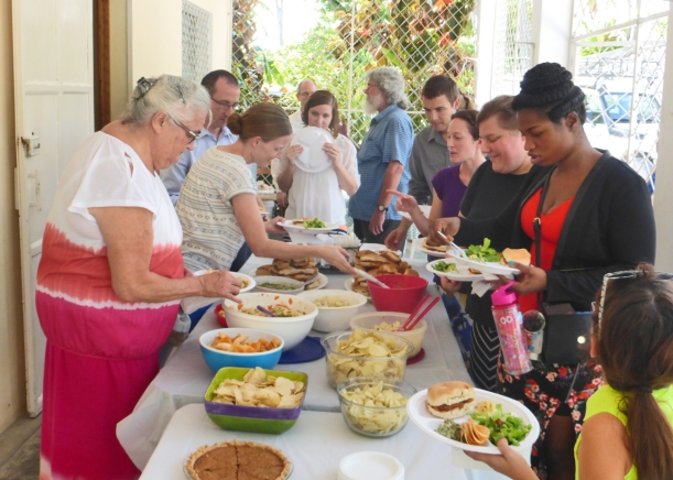 Sharing a meal with locals and visitors after an English service at our home!