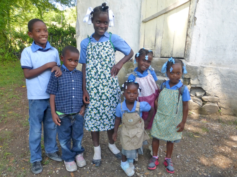 Happy kids modeling their new clothes!