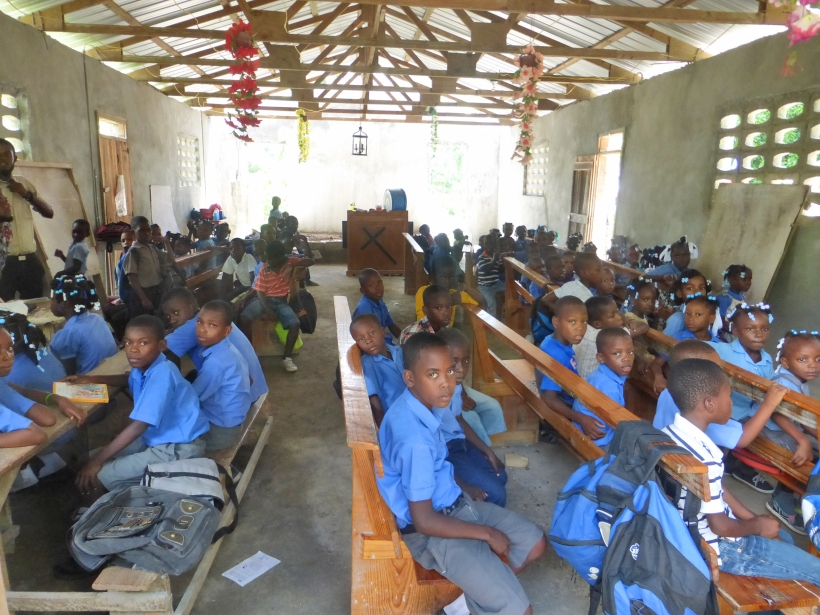 This is a typical school scene. All the classes are in the church in one room!