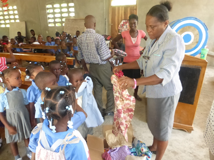 The pastors wife passed out clothes to each child!