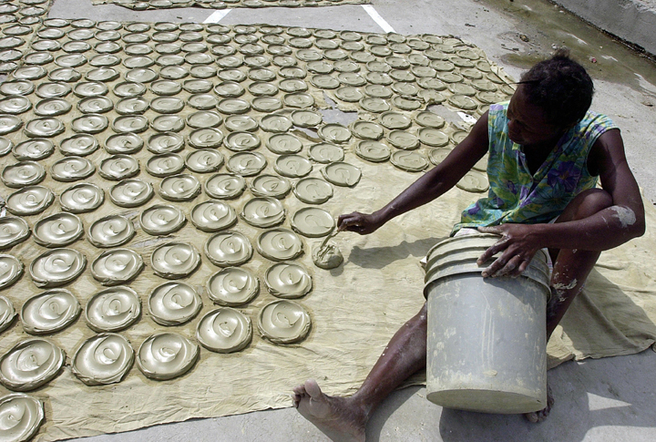 The clay is mixed with salt and vegetable fat and dried in the sun. THONY BELIZAIRE/AFP/Getty Images