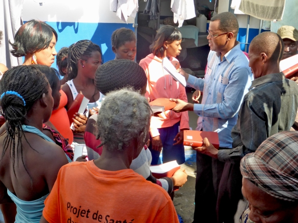 Passing out Bibles and sharing the gospel with prisoners needing new life in Christ.