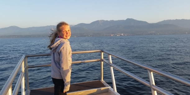 Grace enjoyed the boat ride as we searched for whales!