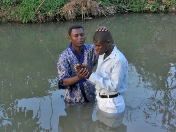 From David's Facebook page, here is a photo of his baptism in 2010!