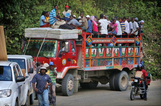 Very few Haitians can afford a car, so they do about anything to get a ride!